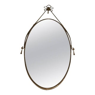 Neoclassical Brass Oval Mirror With a Ribbon Decoration