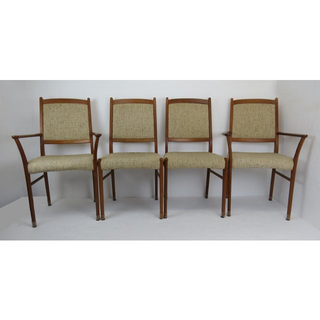 Set of 4 sculptural mid-century modern Danish teak dining chairs (2 armchairs, 2 side chairs). Featuring solid teak frame...