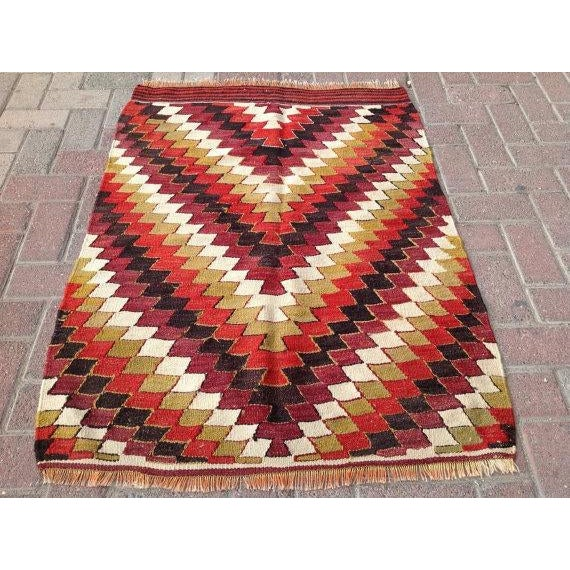 This beautiful vintage handwoven kilim is in fabulous shape. It is approximately 60 years old, handmade of very fine...