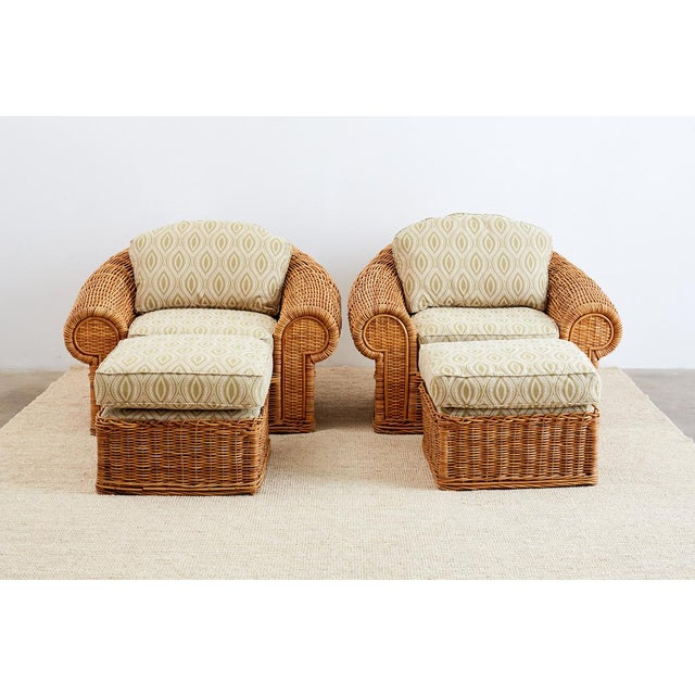 Pair of grand wicker lounge chairs and ottomans inspired by Michael Taylor. Made by Wicker Works in San Francisco, CA....