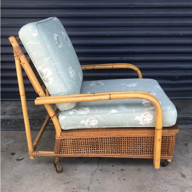 Mid century Ficks Reed rattan lounge chair. Thin rattan frame on casters with woven caning panels. Pencil reed rattan...