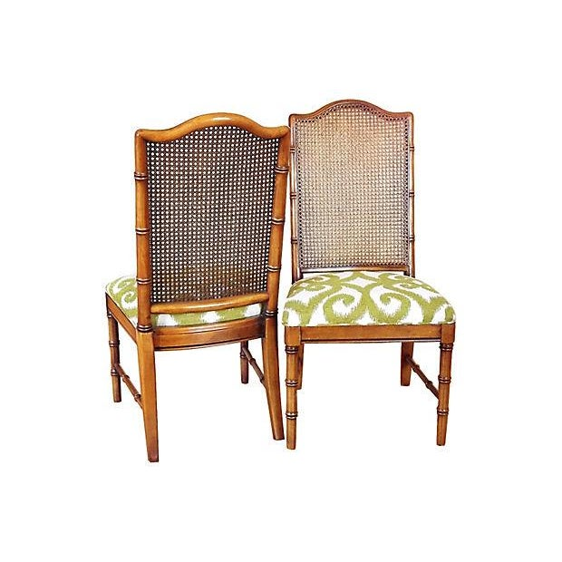 Set of four faux-bamboo side chairs with caned back and newly reupholstered fabric in a green and cream swirl. Maker:...