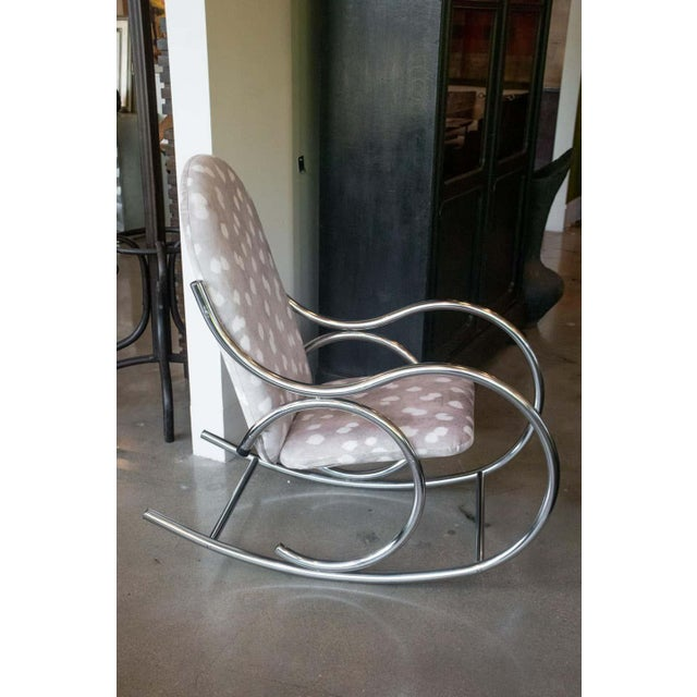Vintage chrome rocking chair gets fresh look with cozy soft, fawn-spotted upholstery. Upholstery is new. Chrome frame is...