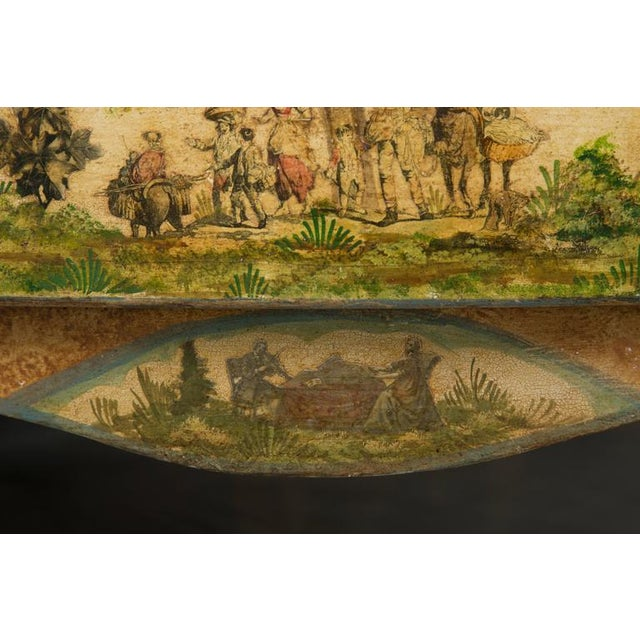 This lovely delicately decoupaged commode with figures in a naturalistic setting has a faux marble top over two long...