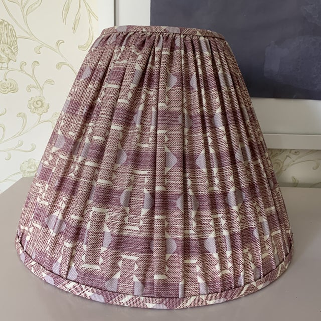 Beautifully made pleated lampshades in a plum purple printed fabric from the chic Textile design co- Fermoie.