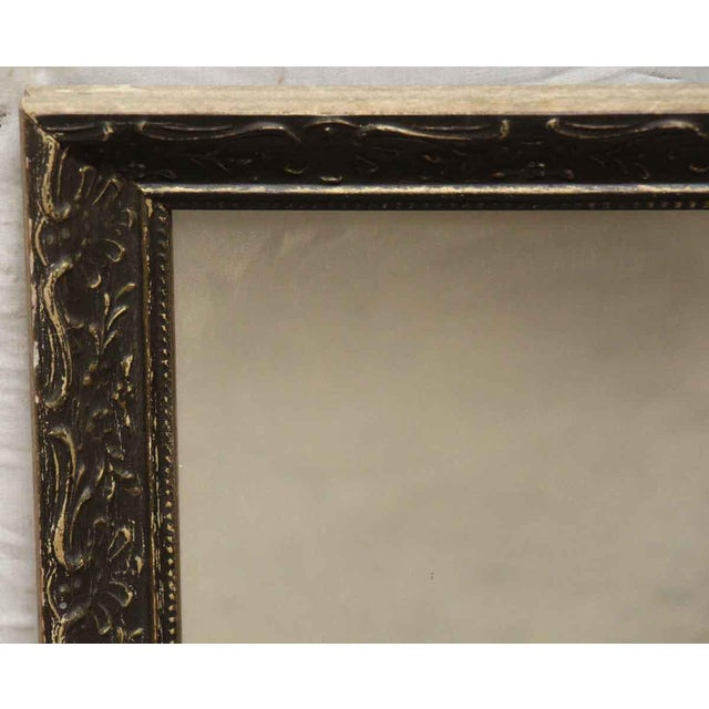 Ornately carved brown painted plaster and wood frame. Will complete any room and it's a must have!