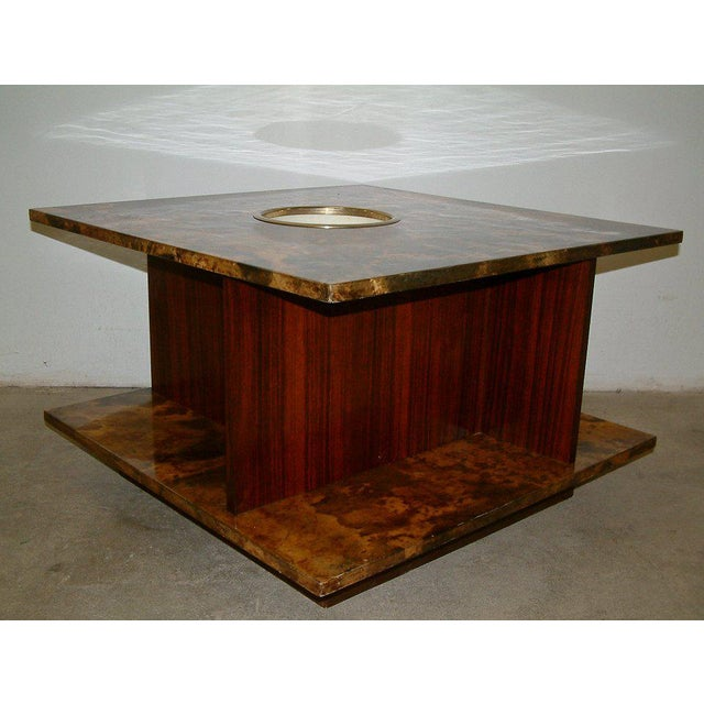 Italy Circa 1950 A modernist goatskin and rosewood table that incorporates elements of high style and luxury in a...