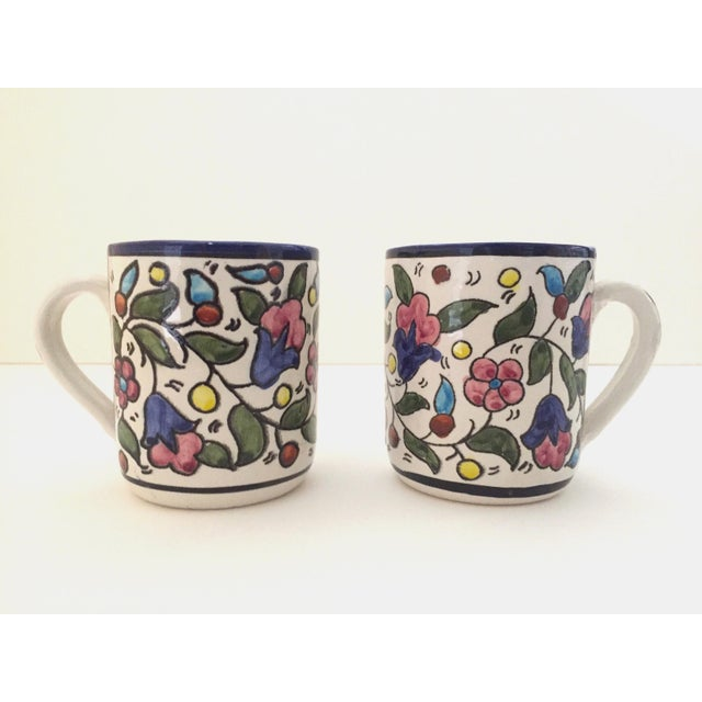 This pair of 2 authentic vintage Jerusalem Pottery handcrafted Armenian floral ceramic hand painted mugs are a very...