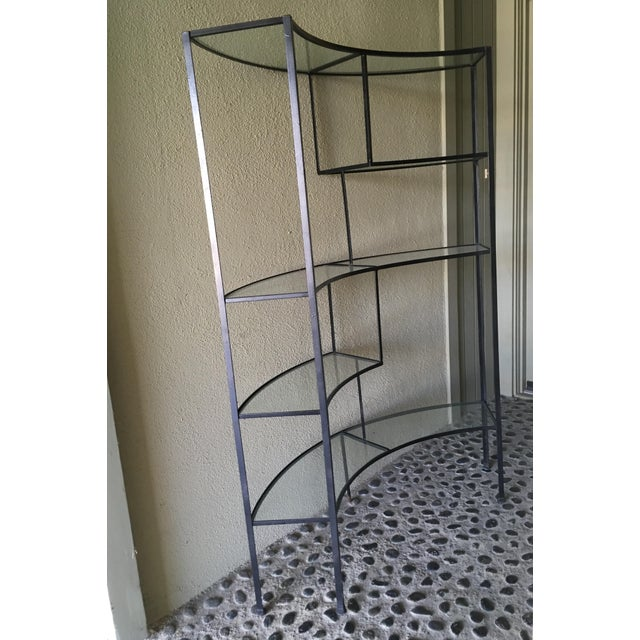 Clear glass and wrought iron shelf designed by Frederic Weinberg. Clear glass shelves give an open and airy feel to this...