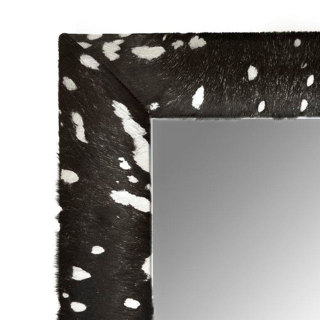 Contemporary black cowhide hair with silver metallic acid wash splash framed beveled mirror by KLASP home. • Made by...