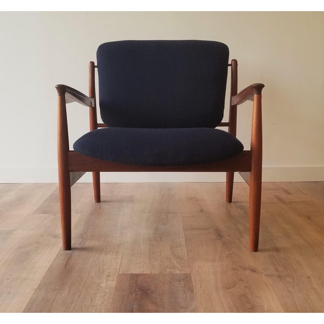 Newly upholstered in Kvadrant Wool and fully restored Teak Lounge Chair (model fd-136) designed by Finn Juhl for France &...