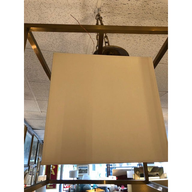 Beautiful brass lantern with ivory shade, ' Caged medium Lantern' by Eric Cohler from CIRCA lighting. Takes one 60 Watts...