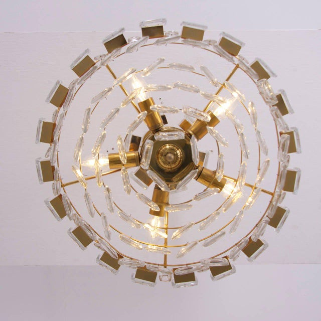 Glamorous gilded brass and glass chandelier. Glass parts look like huge jewels. Fantastic quality and very good condition....