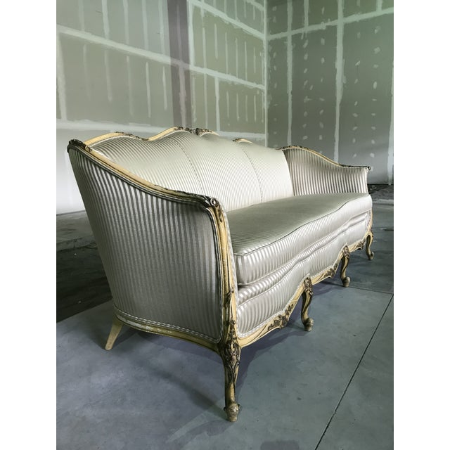 Beautiful Louis XV style sofa/canape with fine carved mahogany frame in original cream finish with gold gilt accentuating...