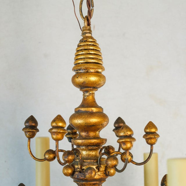Stunning giltwood Italian chandelier in an unconventional, highly decorative style. Made completely from robustly turned...