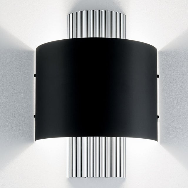 Art deco design wall light with deep vertical polished aluminium ribbing and a satin black metal shade. Certification:...