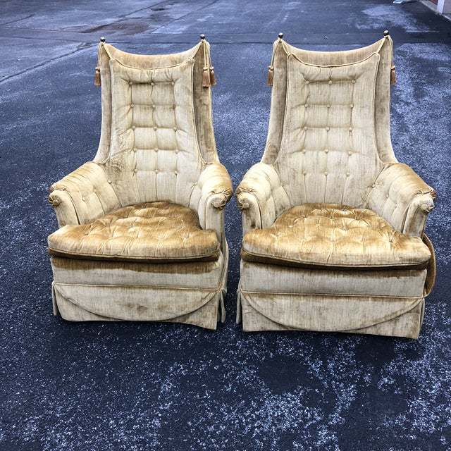 Pair of excellent gold velvet tufted tassel club chairs fit for royalty ! Decorated with brass finials and tassels These...