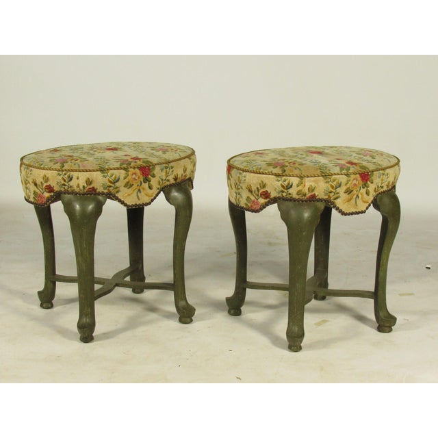 A pair of French Provincial -Style stools by Yale Burge New York, with needlepoint fabric and nailhead trim and original...
