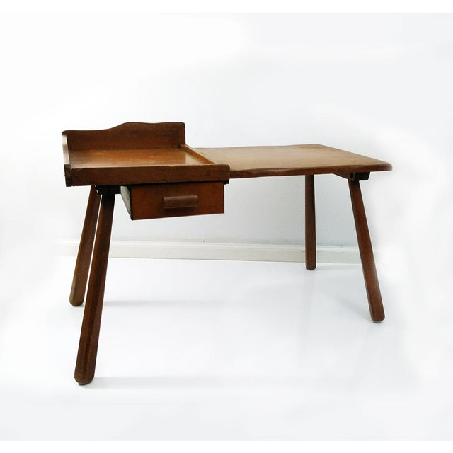 An excellent example of a Early American style cobbler's bench coffee or end table. There is one dovetail drawer and...