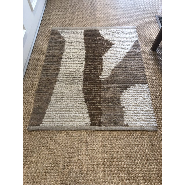Turkish wool accent rug. Measures 2′12″ × 3′9″