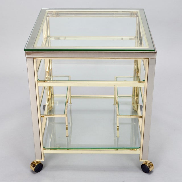 Circa 1960s brass framed bar cart / trolley with bottle racks and two glass shelves.