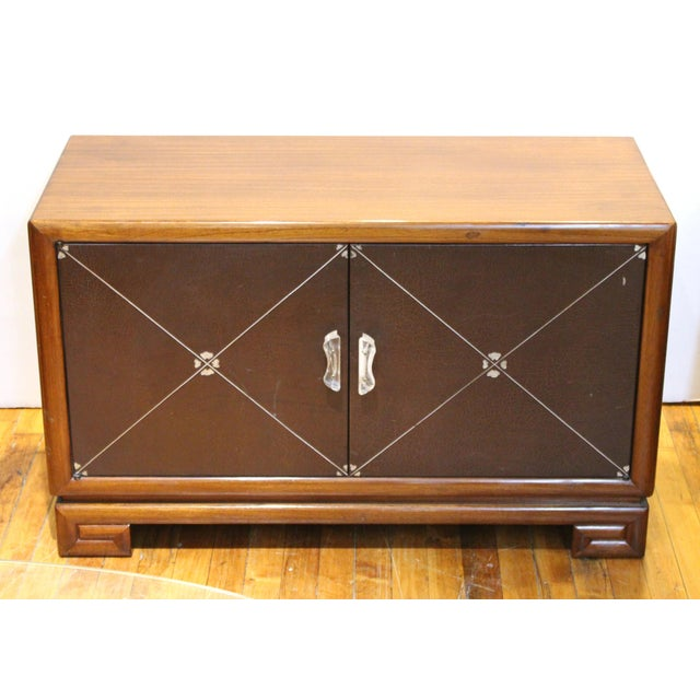 Art Deco low cabinets or nightstands in polished mahogany wood produced in the circa 1940s by Grosfeld House. The pair has...