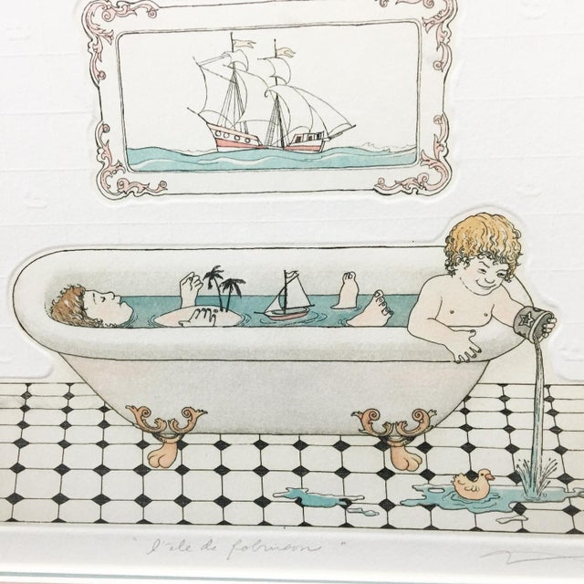 """Signed and numbered etching titled """"L'ile de Robinson."""" Two boys in a clawfoot tub with visions of Robinson Crusoe's..."""