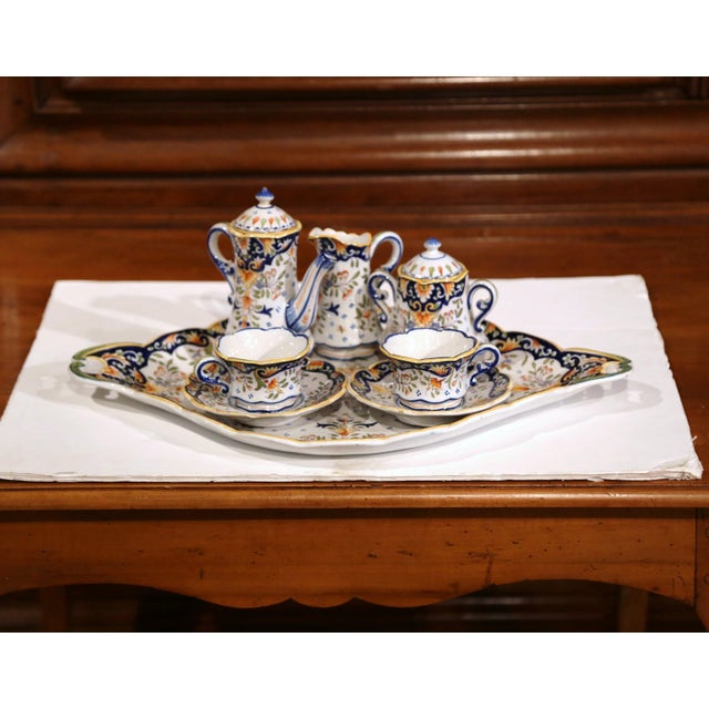 Elegant faience coffee set from France circa 1920; the set includes a large oval tray, two cups with saucers, cream...