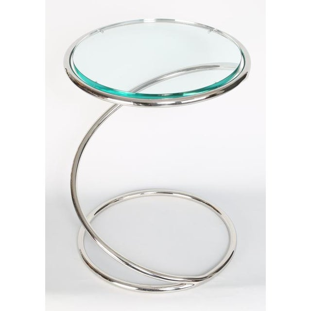Fun 1970s side table in the form of a spring, by Pace Collection. Chrome-plated brass, 1/2-inch glass. See this item in...