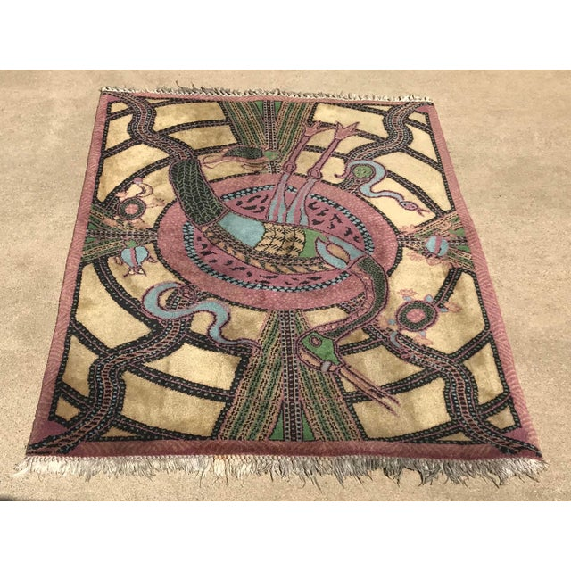 I love this rare animal rug with a large bird in the center and turtles, snakes and fish interwoven in the Design.