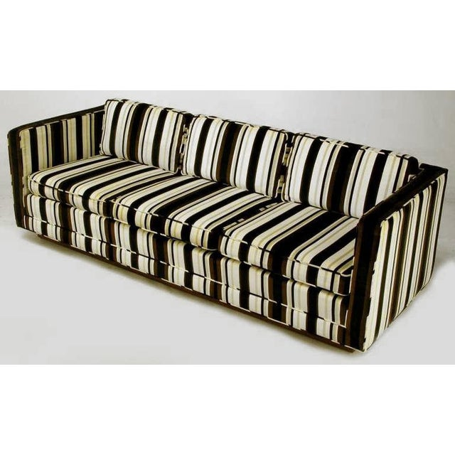 Three seat even arm tuxedo sofa in striped brown, black, taupe and white velvet upholstery. Loose seat and back cushions,...