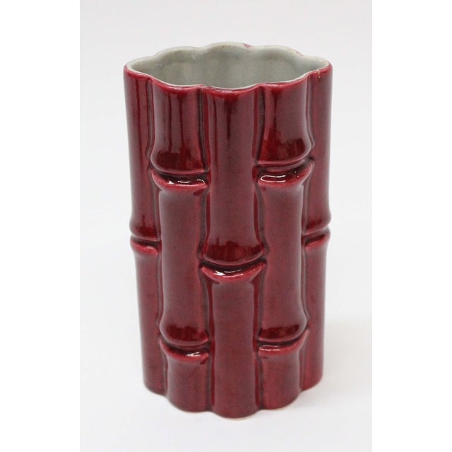 Here is a hard-to-find Mid-Century Red Wing pottery bamboo vase. Maker's mark is on the bottom.