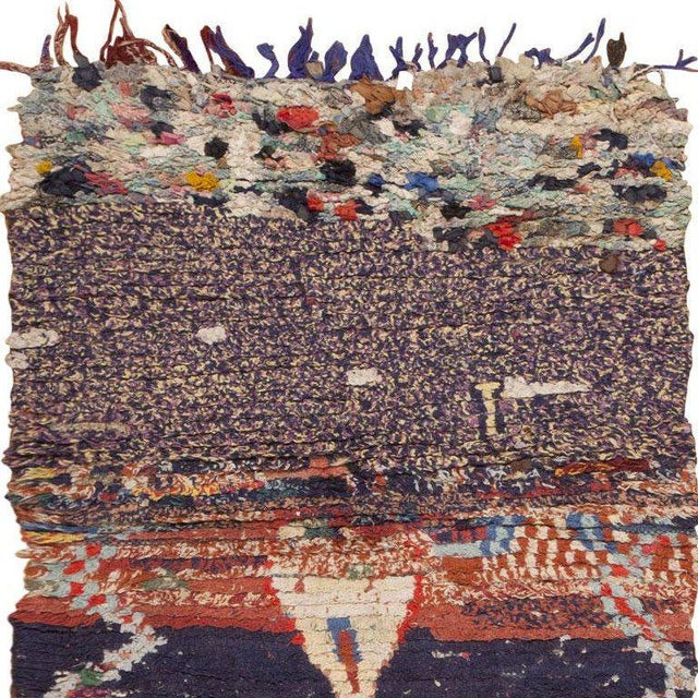 This handsome vintage rug from Morocco features an enthralling selection of discrete motifs that are combined in a...