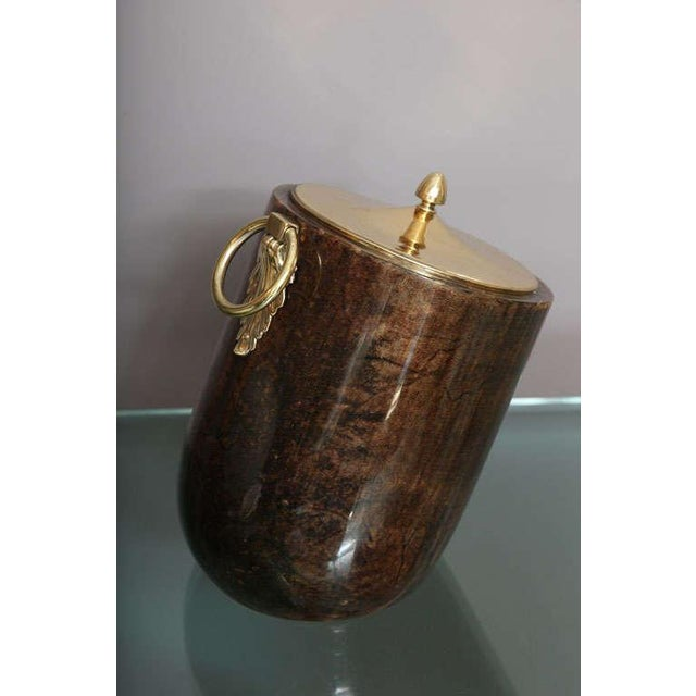 Unique tilted table top ice bucket in brown goatskin and brass by Aldo Tura (SIGNED).