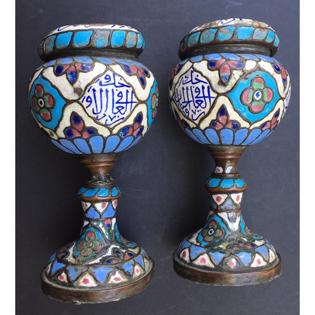 This is an exceptional and historic pair of Damascus enameled metalwork vessels or urns. These Syrian art objects show...