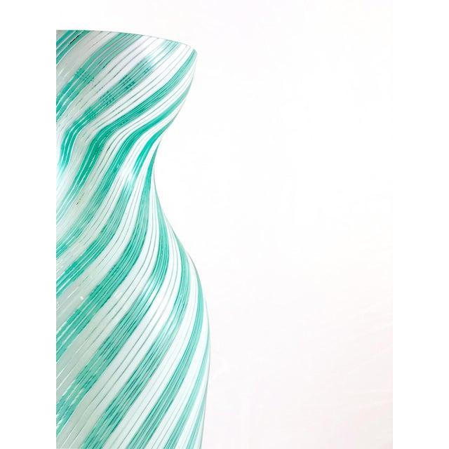 The dino martens vase made of murano glass half-filigrana for the aureliano toso vetreria of 1954. (Watermark: ancient hot...