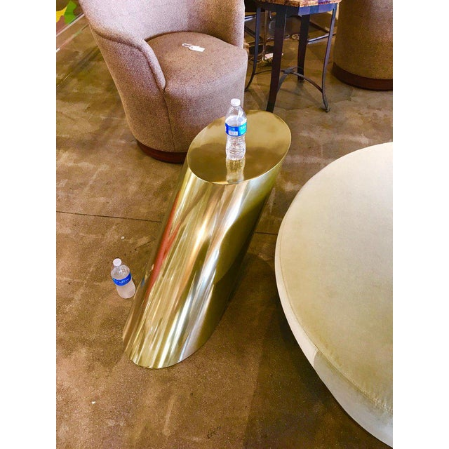 Brass coated heavy steel slanted angle table. It is extremely heavy and well made. The brass coating is quite shiny as you...