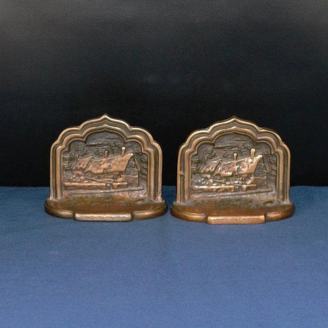 An interesting set of bookends in copper plated cast bronze. They feature a thatched roof house scene with Stratford on...