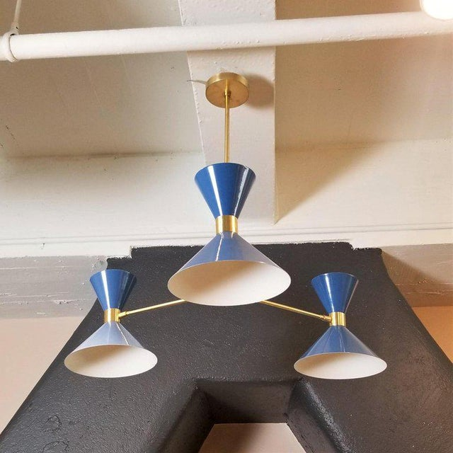"""The """"Monarch"""" 3-Arm Pendant or small chandelier shown in unlacquered brass and our high-gloss """"Greece"""" cobalt blue enamel..."""