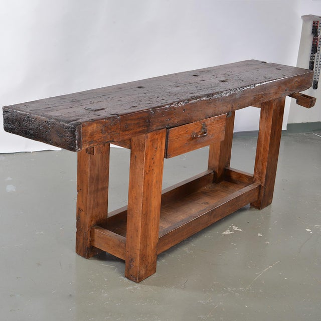 Circa 1860s French wooden work bench table. Long, narrow and very sturdy, this makes a great console or bar table. Bench...