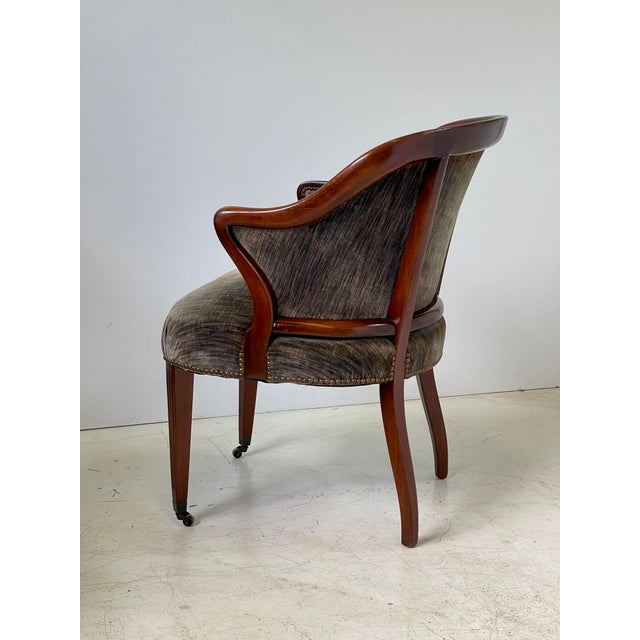 20th Century Art Deco side chair of elegant proportions made of an exposed and finished mahogany frame, upholstered in a...