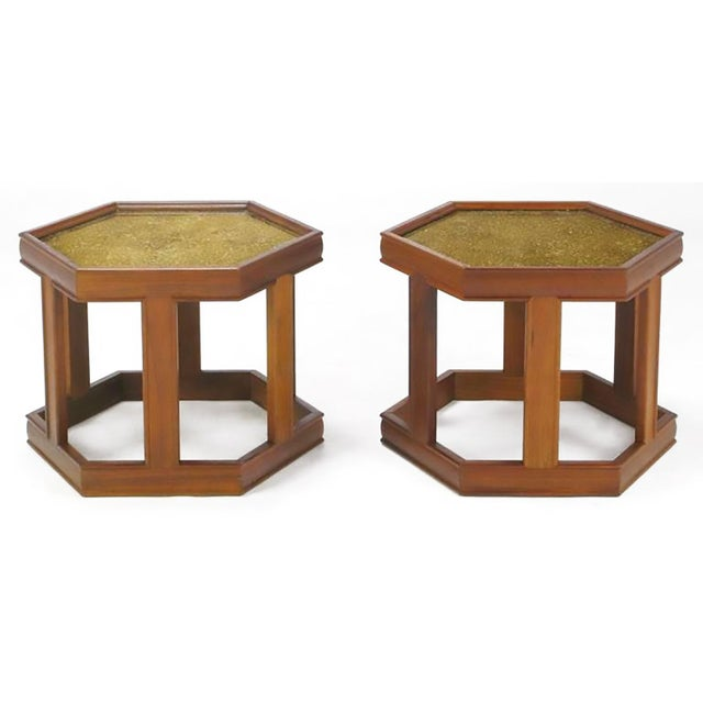 Pair of hexagonal side tables by John Keal for Brown Saltman. Finished in a medium walnut, with a brilliant reverse-...