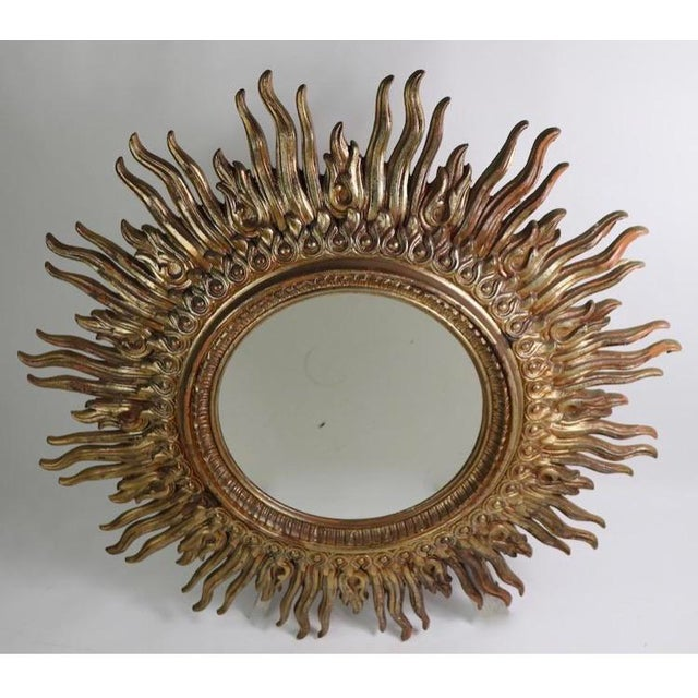 Large Hollywood Regency Sunburst Wall Mirror. Condition is Used. DIMENSIONS 48ʺW × 2ʺD × 48ʺH Large circular sunburst...