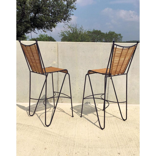 Rare pair of iron and cane bar stools attributed to Pipsan Saarinen Swanson for Ficks Reed from the 1950's. Daughter of...