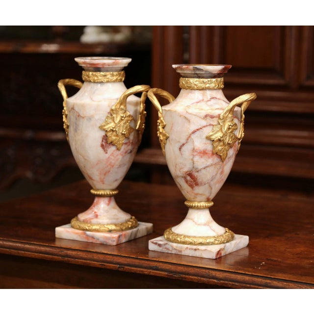 Decorate a mantel with this elegant pair of antique beige marble and bronze doré cassolettes vases. Created in France,...