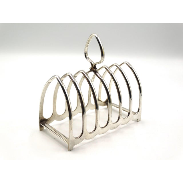 Fine quality English silver-plate toast rack marked Mappin & Webb, Sheffield. This large 6 slice rack can also double to...