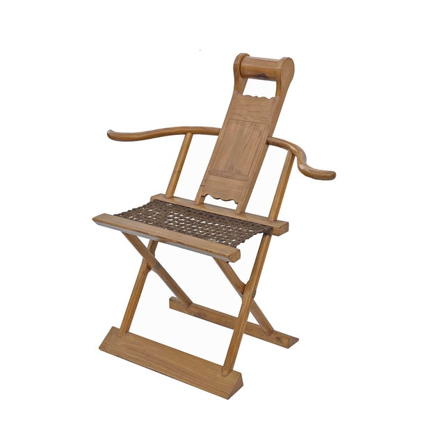 This is an oriental folding chair with a light brown color finish and wool mat seat. It has a simple slim wide arm design....
