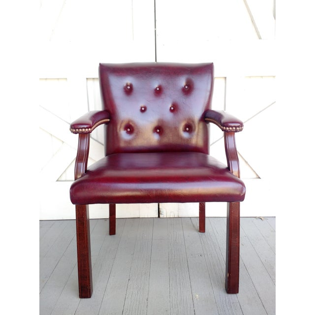 This is a beautiful Oxblood Vinyl Guest Chair by Hon. I love the deep burgundy color of the vinyl, rich mahogany colored...