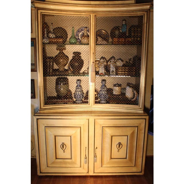 Grosfeld House lacquered parchment china Cabinet with base Hollywood Regency period. It is rare to have original gilt...
