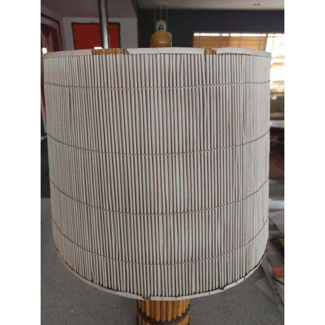 This is a great pair of one owner, my family, 1940's rattan table lamps with the original shades. They are in original...